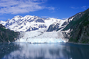 Aerial view of Surprise Glacier flowing out of the Chugach Mountains into Harriman Fjord, Prince William Sound, Southcentral, Alaska