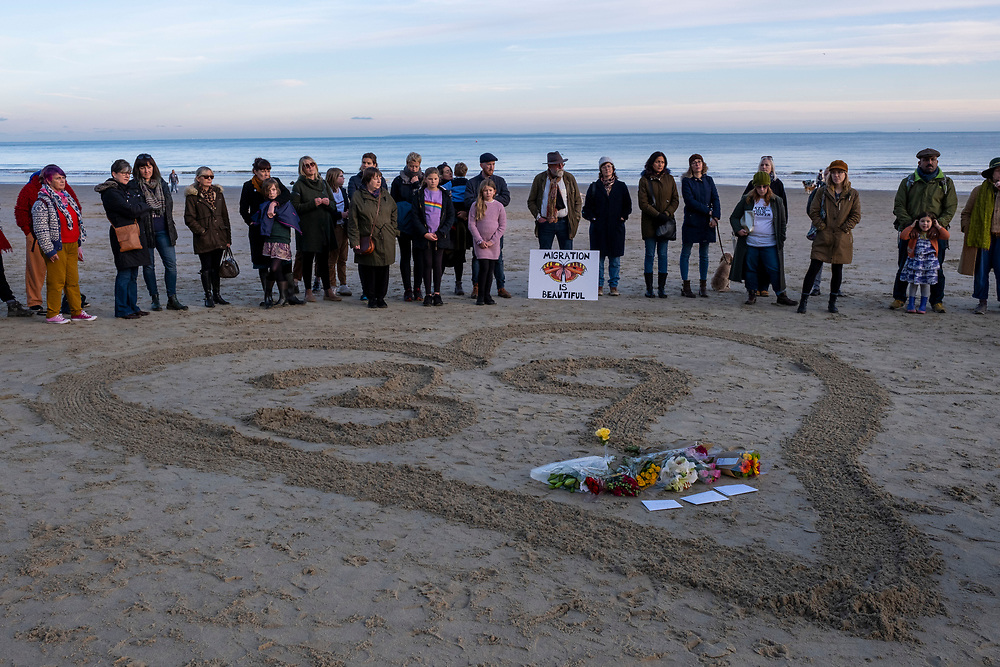 Local residents of the Kent seaside town of Folkestone gather around a heart with the figure 39 in it on Sunny Sands Beach, Folkestone, Kent, UK. The vigil was organised by locals to remember the 39 people discovered in Essex from Vietnam who perished in the back of a truck while being trafficked into the UK inside a refrigerated container. (Image © Andy Aitchison)<br /> (photo by Andrew Aitchison / In pictures via Getty Images)