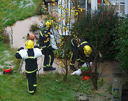 © Licensed to London News Pictures. 25/11/2012..North East England..Using sandbags to prevent further damage a fire crew attend a call to a flooded house on the outskirts of Saltburn this morning as heavy overnight rain caused traffic disruption and flooding in parts of Cleveland and North Yorkshire...Photo credit : Ian Forsyth/LNP