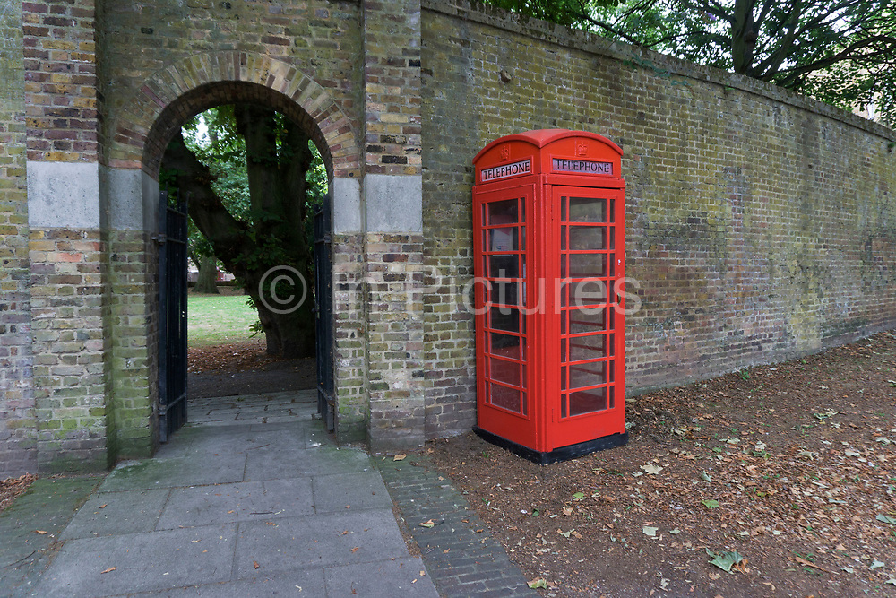 Fake red telephone call box in Wapping, London, UK. This traditional phone box appeared one day for no apparent reason. Then disappeared a few days later.
