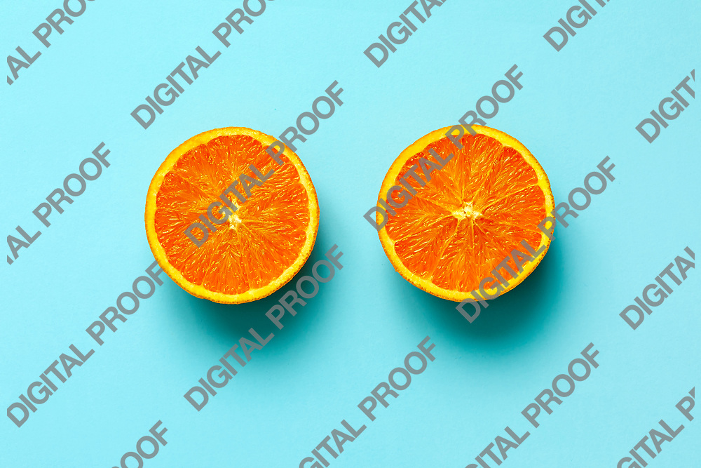 Orange fruit. Orange half fruit sliced isolate on blue background seen from above flatlay style, close up.