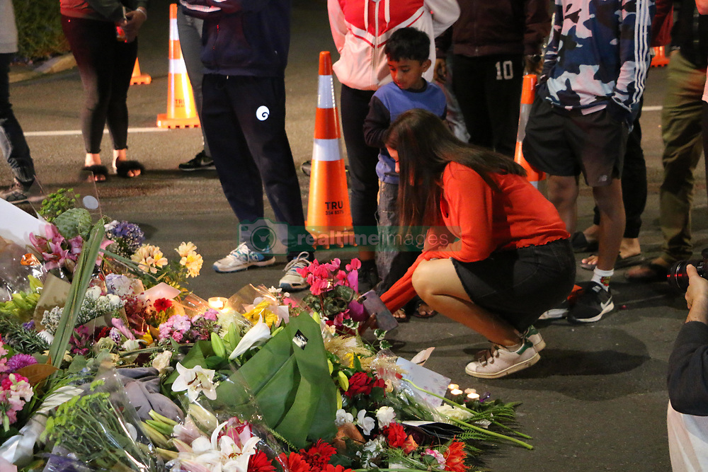 March 16, 2019 - Christchurch, New Zealand - A young girl seen laying down flowers to pay respect to the victims of the Christchurch mosques shooting. Around 50 people has been reportedly killed a terrorist attack on two Christchurch mosques. (Credit Image: © Adam Bradley/SOPA Images via ZUMA Wire)