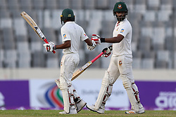 August 28, 2017 - Mirpur, Bangladesh - End of second day, Bangladeshi batsman Tamim Iqbal an night watchman Taijul Islam are walking towards the pavilon  during day two of the First Test match between Bangladesh and Australia at Shere Bangla National Stadium on August 28, 2017 in Mirpur, Bangladesh. (Credit Image: © Ahmed Salahuddin/NurPhoto via ZUMA Press)