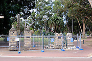 The Stirling Memorial Gates after a large tree branch fell on them, and before the restoration work commissioned by the City of Swan.