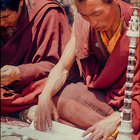 A Tibetan Buddhist monk chants scripture at an outdoor puja ceremony in Tengboche Monastery in the Khumbu region of Nepal's Himalaya. (1974)