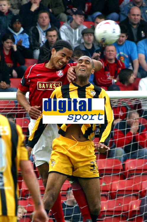 Photo: Dave Linney.<br />Walsall v Port Vale. Coca Cola League 1. 15/04/2006.<br />Walsall's Chris Westwood (L) beats Leon Constantine to the ball.