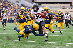 Nov 23, 2019; Morgantown, WV, USA; Oklahoma State Cowboys running back Chuba Hubbard (30) runs after a catch and tackled by West Virginia Mountaineers cornerback Keith Washington Jr. (28) during the first quarter at Mountaineer Field at Milan Puskar Stadium. Mandatory Credit: Ben Queen-USA TODAY Sports