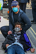 Protestor Removal Police unit work to unchain members of Extinction Rebellion Youth Cambridge who chained themselves in Bamboo lock-on creating a roadblock protest action outside Baringa Partners building in London on Thursday, Sept 10, 2020 - in an attempt to highlight the involvement of Schlumberger Limited in what they call 'ecocide'. Schlumberger is an oilfield services company working in more than 120 countries and has four principal executive offices located in Paris, Houston, London, and The Hague. An article at the Guardian suggests that it's ubiquitous in fossil fuel operations across the world, has more staff than Google, turns over more than Goldman Sachs, and is worth more than McDonald's – yet you won't have heard of it. XR Youth of Cambridge said that the British government gave 'Schlumberger' a no-strings-attached £150 million bailout loan as it was laying off a fifth of its global workforce. Another activist added: 'Schlumberger is hiding in plain sight here in Westminster. Every day, hundreds of people walk past this building with no idea that they're on the doorstep of a climate crime scene.'<br /> Environmental nonviolent activists group Extinction Rebellion enters its 10th and final day of continuous ten days protests to disrupt political institutions throughout peaceful actions swarming central London into a standoff, demanding that central government obeys and delivers Climate Emergency bill. (VXP Photo/ Vudi Xhymshiti)