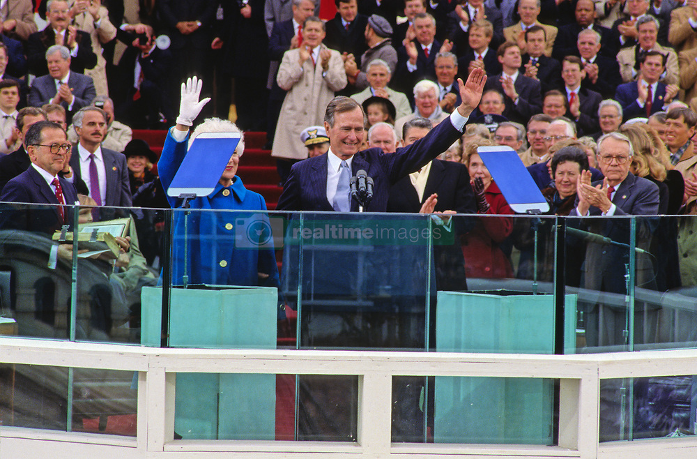 United States President George H.W. Bush waves as he delivers his Inaugural Address after being sworn-in as 41st President of the United States at the US Capitol on January 20, 1989. Photo by Louis Jacobson / CNP /ABACAPRESS.COM