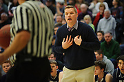 MMU head coach Jeff Davis talks to the referee during the Vermont state division I boys basketball championship game between the Mount Mansfield Cougars and the Rutland Raiders at Patrick Gym on Saturday afternoon March 17, 2018 in Burlington. (BRIAN JENKINS/for the FREE PRESS)