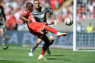 Leyton Orient's Moses Odubajo striking the ball .Skybet football league one play off final match , Leyton Orient  v Rotherham Utd at Wembley Stadium in  London on Sunday 25th May 2014.<br /> pic by John Patrick Fletcher, Andrew Orchard sports photography.