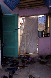 YAFTAL PAYAN, 31 July 2005..The entryway to Bitha Bala Vocational Training Centre....The VTC aim is to improve the status of women, by giving them lessons on reproductive health, family planning and post-natal issues. ....According to United Nations Population Fund, Afghanistan has among the world?s highest rates of maternal mortality, and Badakhshan has the highest rates ever recorded anywhere in the world, with one mother dying in every 15 births. Underage marriage is one of the primary causes of maternal mortality.....The VTC is funded by UNFPA and implemented by IBNSINA.