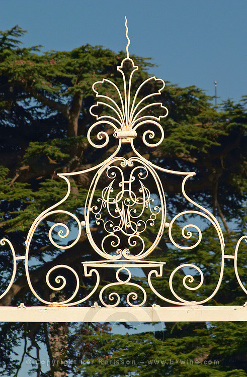 The entrance gate to Chateau Beychevelle in Saint Julien. Monogram with the letters A H A M L