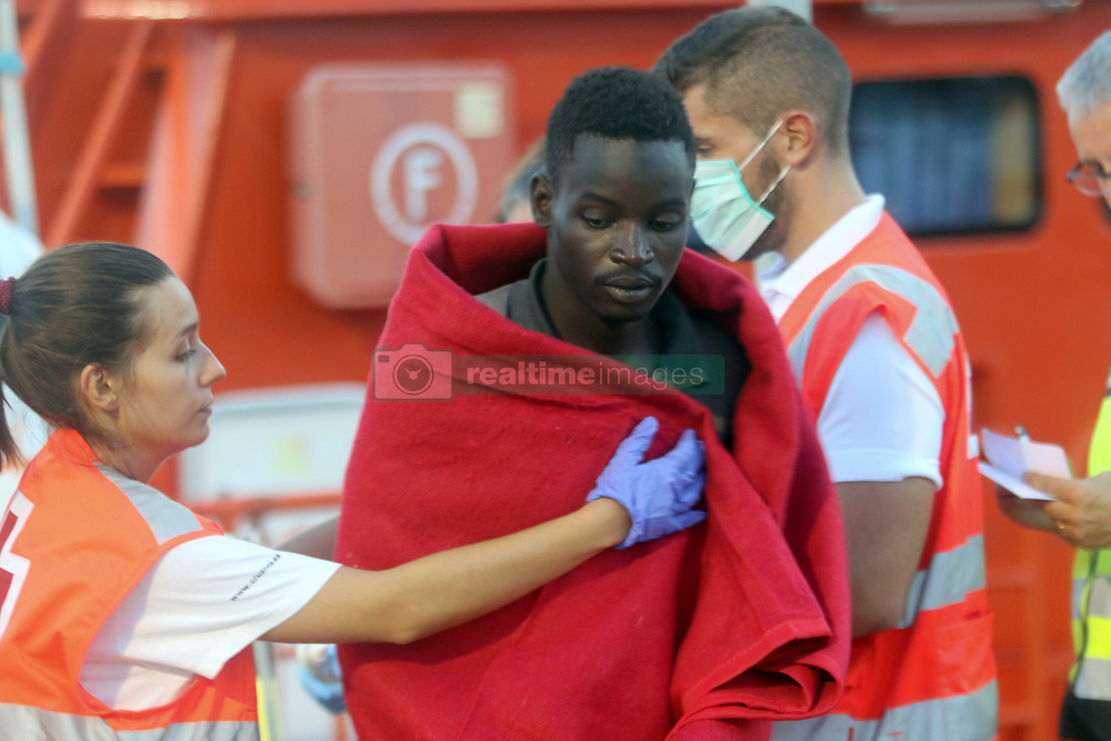 August 7, 2017 - Malaga, Spain - A migrant reacts after being rescued. Rescue Maritime has rescued 14 migrants, including seven women, who were traveling on a boat 14 miles south of Benajarafe. (Credit Image: © Fotos Lorenzo Carnero via ZUMA Wire)