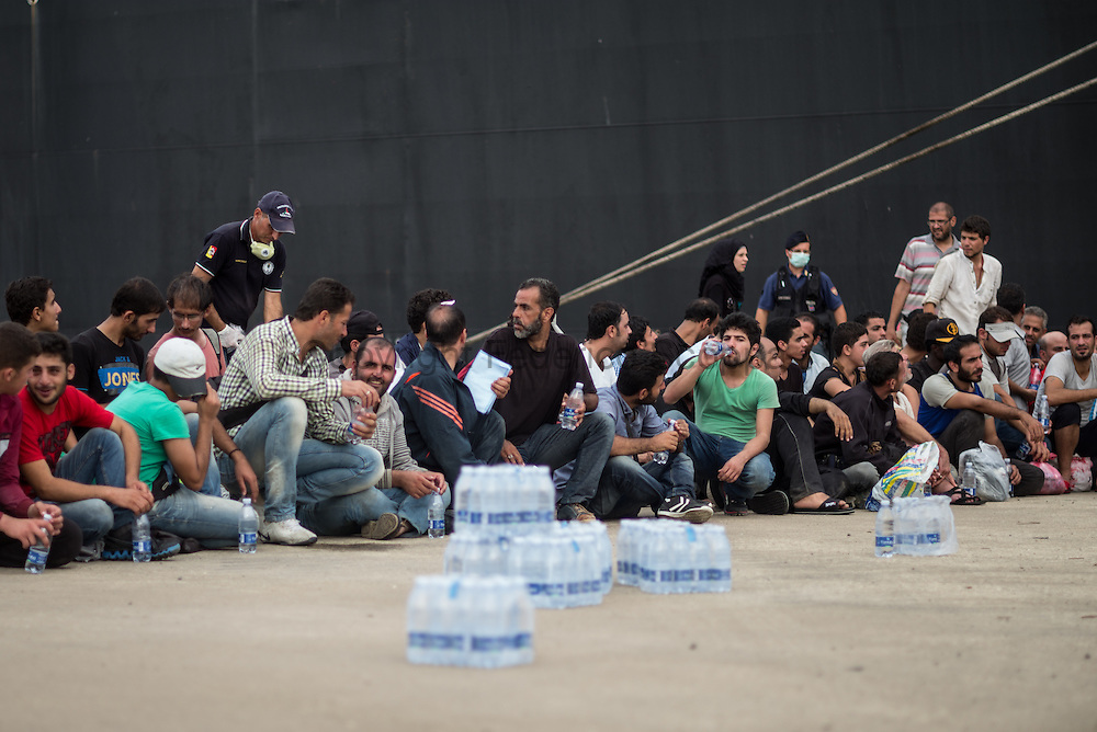 Migrants waiting to be moved to the identification center in Augusta