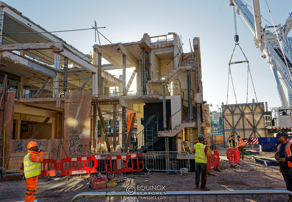 London, United Kingdom - 20 September 2019<br /> EXCLUSIVE SET - Aerial construction specialists and demolition experts use a huge crane to carefully lift intact, a twenty five ton, two-story wall, to preserve a famous Banksy rat image which has been covered up for years. Teams from specialist companies have spent over six weeks cutting around the artwork and fitting custom made eight ton steel supports to enable them to save the historic piece of art. Work has started on the construction of a new twenty seven floor art'otel hotel on the site of the old Foundry building in Shoreditch, east London, and a condition of the planning permission was to preserve the historical Banksy graffiti. A second section of the painting, an image of a TV being thrown through a broken window has already been cut out and moved separately. After the hotel construction is complete the two parts of the Banksy painting will be displayed on the hotel. Our pictures show the stages of work to protect the image, culminating in the lifting of the three story wall by crane. Video footage also available.<br /> (photo by: EQUINOXFEATURES.COM)<br /> Picture Data:<br /> Photographer: Equinox Features<br /> Copyright: ©2019 Equinox Licensing Ltd. +443700 780000<br /> Contact: Equinox Features<br /> Date Taken: 20190920<br /> Time Taken: 17342310<br /> www.newspics.com