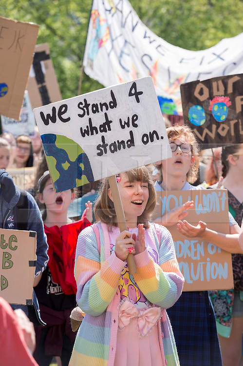 © Licensed to London News Pictures. 24/05/2019. Bristol, UK. Youth Strike 4 Climate outside Bristol City Hall on College Green. The Bristol event is part of a series of UK wide and international days of protest as students and school pupils across the world miss classes, striking to protest a lack of governments' action to combat the climate crisis. School students around the world have gone on strike to demand action on climate change. Organisers expect more than one million young people to join the protests in at least 110 countries on Friday 24 May. The international movement was started by Swedish student Greta Thunberg and led to various movements across Europe, the US and Australia, known as Fridays for Future or School Strike for Climate. The last co-ordinated international protest took place on 15 March, with an estimated 1.6 million students from 125 countries walking out of school. Photo credit: Simon Chapman/LNP.