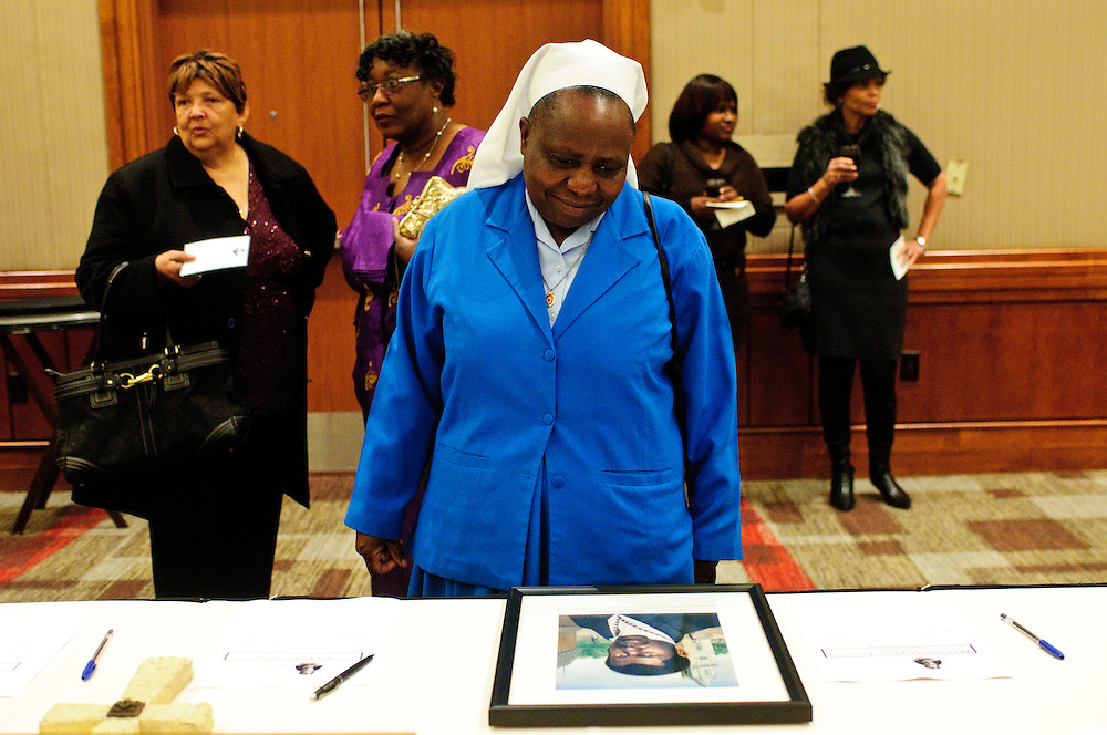 Sister Margaret Nyangireki of St. Thaddeus Catholic Church reviews a selection of items available for silent auction during the second annual Gala for the Cause for Sainthood of Father Augustus Tolton at the Hyatt Regency McCormick Place on Friday, October 19th, 2012. The event is sponsored by The Archdiocese of Chicago's Office for Black Catholics, The Father Tolton Guild and the Office of Vicariate VI and Bishop Joseph Perry l Brian J. Morowczynski~ViaPhotos..For use in a single edition of Catholic New World Publications, Archdiocese of Chicago. Further use and/or distribution may be negotiated separately. ..Contact ViaPhotos at 708-602-0449 or email brian@viaphotos.com.   .The Archdiocese of Chicago's Office for Black Catholics hosts it's second annual Gala for the Cause for Sainthood of Father Augustus Tolton at the Hyatt Regency McCormick Place on Friday, October 19th, 2012. The event is co-sponsored by The Father Tolton Guild and the Office of Vicariate VI and Bishop Joseph Perry.