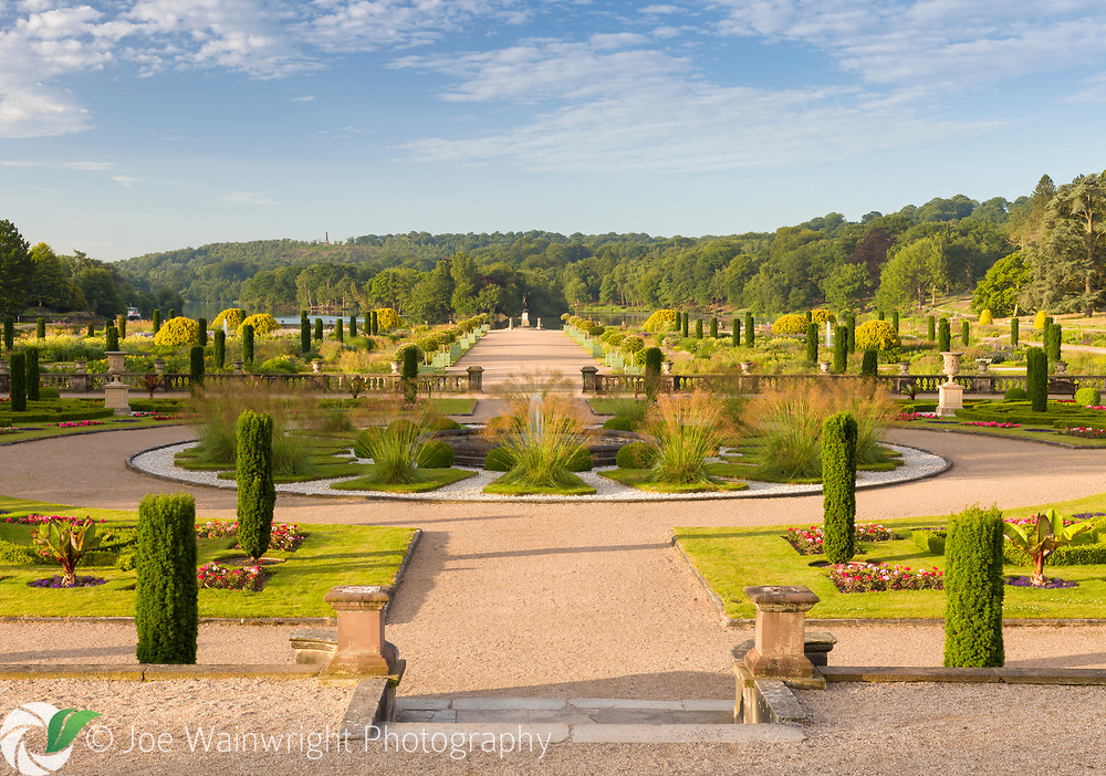 A view over the formal Upper Flower Garden, down over the Italian Garden at Trentham Gardens, Staffordshire - designed by Tom Stuart-Smith. Planting in the Upper Flower Garden includes Pelargoniums, Begonias, Stipa gigantea and fastigate Irish yews