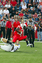 10 September 2011: Marvon Sanders get one leg out and one leg caught by Justin Cox on a punt return during an NCAA football game between the Morehead State Eagles and the Illinois State Redbirds at Hancock Stadium in Normal Illinois.