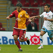 Galatasaray's Juan Emmanuel CULIO (L) and Trabzonspor's Alan Carlos Gomes Da COSTA (R) during their Turkish superleague soccer derby match Galatasaray between Trabzonspor at the TT Arena in Istanbul Turkey on Sunday, 10 April 2011. Photo by TURKPIX