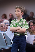 A young boy waits for the answer to his question from U.S. Sen. Tim Scott during a town hall meeting with constituents February 18, 2017 in Mount Pleasant, South Carolina. Hundreds of concerned residents turned up for the meeting to address their opposition to President Donald Trump during a vocal meeting held by U.S. Rep. Mark Sanford and Senator Tim Scott.