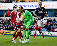 Millwall's David Forde claims the ball despite the attentions of Middlesbrough's Jelle Vossen<br /> <br /> Photographer Craig Mercer/CameraSport<br /> <br /> Football - The Football League Sky Bet Championship - Millwall v Middlesbrough - Saturday 6th December 2014 - The Den - London<br /> <br /> © CameraSport - 43 Linden Ave. Countesthorpe. Leicester. England. LE8 5PG - Tel: +44 (0) 116 277 4147 - admin@camerasport.com - www.camerasport.com