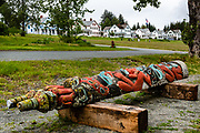 A totem pole at the Alaska Indian Arts skill center, in Fort William H. Seward National Historic Landmark, at Port Chilkoot, in Haines, Alaska, USA. Also known as Chilkoot Barracks and Haines Mission, Fort Seward (1902-1945) was the last of 11 military posts in Alaska during the gold rush era, and Alaska's only military facility between 1925 and 1940. It policed miners moving into the gold mining areas in the Alaskan interior, and provided military presence during negotiations over the nearby international border with Canada. William H. Seward was the United States Secretary of State who oversaw the Alaska purchase.