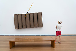 Woman looking at art installation Untitled 1985 by Joseph Beuys at Hamburger Bahnhof art museum in Berlin, Germany. .Editorial Use Only.