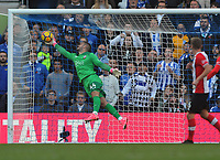 Football - 2017 / 2018 Premier League - Brighton & Hove Albion vs. Southampton<br /> <br /> Glenn Murray of Brighton heads his goal past the diving Southampton goalkeeper, Fraser Forster at The Amex.<br /> <br /> COLORSPORT/ANDREW COWIE