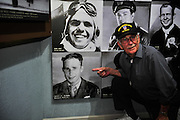 """KUNMING, CHINA - SEPTEMBER 06: (CHINA OUT)<br /> <br /> Flying Tiger Veterans Visit The Cultural Relics Exhibition Of The Flying Tigers In Kunming<br /> <br /> A Flying Tiger veteran points at the photo of himself at The Cultural Relics\' Exhibition of the \""""Flying Tigers\"""" at Kunming Museum on September 6, 2015 in Kunming, Yunnan Province of China.<br /> <br /> The 1st American Volunteer Group (AVG) of the Chinese Air Force in 1941–1942, nicknamed the Flying Tigers, was composed of pilots from the United States Army Air Corps (USAAC), Navy (USN), and Marine Corps (USMC), recruited under presidential authority and commanded by Claire Lee Chennault. The shark-faced nose art of the Flying Tigers remains among the most recognizable image of any individual combat aircraft or combat unit of World War II.<br /> ©Exclusivepix Media"""
