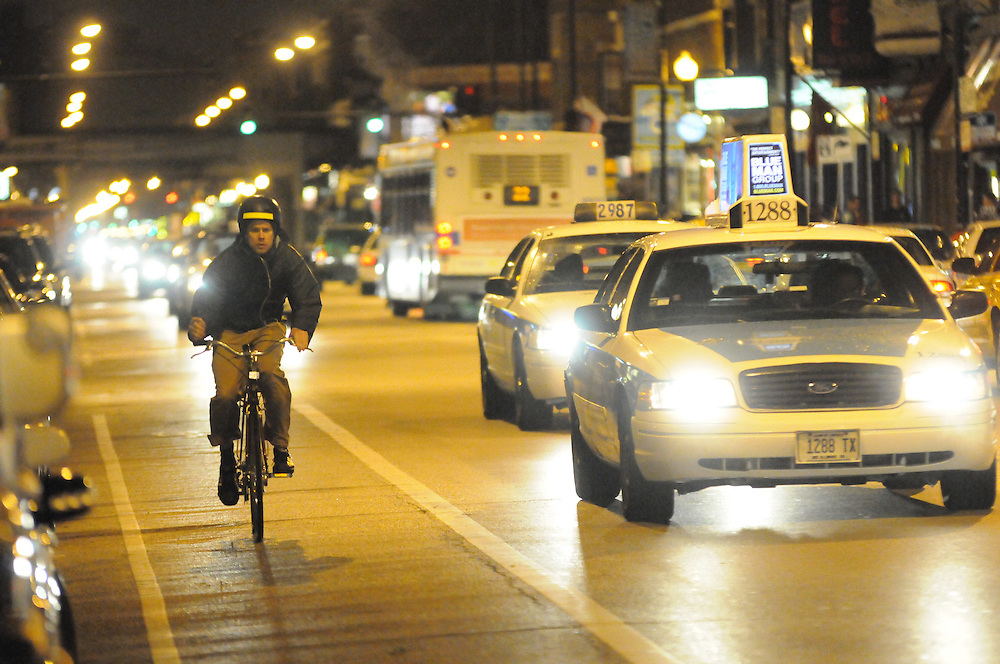 Pedestrians and bar-goers on N. Clark St. in Wrigleyville are offered a variety of options to get them home, whether walking, hailing a cab, biking, or hopping a bus.