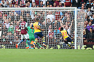 Danny Welbeck of Arsenal (23) spins away to celebrate scoring his side's second goal. Barclays Premier league match, Aston Villa v Arsenal at Villa Park in Birmingham on Saturday 20th Sept 2014<br /> pic by Mark Hawkins, Andrew Orchard sports photography.