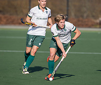 ROTTERDAM - Menno Boeren (Rotterdam) met Marnix Kleinsman (Rotterdam)    tijdens de competitie hoofdklasse hockeywedstrijd mannen,  Rotterdam-Bloemendaal (1-2).  COPYRIGHT  KOEN SUYK