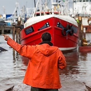 Mallaig Boatyard. Head boatbuilder/ foreman Graham MacKenzie guides the Ranger onto the cradle.  Picture Robert Perry 9th April 2016<br /> <br /> Must credit photo to Robert Perry<br /> FEE PAYABLE FOR REPRO USE<br /> FEE PAYABLE FOR ALL INTERNET USE<br /> www.robertperry.co.uk<br /> NB -This image is not to be distributed without the prior consent of the copyright holder.<br /> in using this image you agree to abide by terms and conditions as stated in this caption.<br /> All monies payable to Robert Perry<br /> <br /> (PLEASE DO NOT REMOVE THIS CAPTION)<br /> This image is intended for Editorial use (e.g. news). Any commercial or promotional use requires additional clearance. <br /> Copyright 2014 All rights protected.<br /> first use only<br /> contact details<br /> Robert Perry     <br /> 07702 631 477<br /> robertperryphotos@gmail.com<br /> no internet usage without prior consent.         <br /> Robert Perry reserves the right to pursue unauthorised use of this image . If you violate my intellectual property you may be liable for  damages, loss of income, and profits you derive from the use of this image.