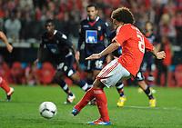 20120331: LISBON, PORTUGAL – Portuguese Liga Zon Sagres 2011/2012 - SL Benfica vs CS Braga.<br />In picture: Benfica's midfielder Axel Witsel, from Belgium, shoots to score the opening goal.<br />PHOTO: Alvaro Isidoro/CITYFILES