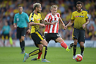 James Ward-Prowse of Southampton © challenges Valon Behrami of Watford. Barclays Premier League, Watford v Southampton at Vicarage Road in London on Sunday 23rd August 2015.<br /> pic by John Patrick Fletcher, Andrew Orchard sports photography.