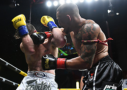 July 28, 2018 - Mashantucket, CT, U.S. - MASHANTUCKET, CT - JULY 28: Chip Moraza-Pollard (red tape) takes on Mark MacKinnon (blue tape) in a World Cruiserweight Title bout on July 28, 2018 at Lion Fight 45 at the Fox Theater of Foxwoods Casino in Mashantucket, Connecticut. Chip Moraza-Pollard defeats Mark MacKinnon via decision. (Photo by Williams Paul/Icon Sportswire) (Credit Image: © Williams Paul/Icon SMI via ZUMA Press)