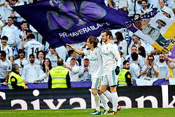 MADRID, Jan. 22, 2018  Real Madrid's Luca Modric (L) celebrates with his teammate Gareth Bale during a Spanish league match between Real Madrid and Deportivo de la Coruna in Madrid, Spain, on Jan. 21, 2018. Real Madrid won 7-1. (Credit Image: © Juan Carlos/Xinhua via ZUMA Wire)