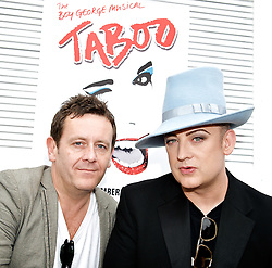 Boy George <br /> <br /> announcing the come back of the Boy George musical 'Taboo' at Brixton Club House in September 2012 <br /> <br /> press conference <br /> 26th June 2012 <br /> <br /> Paul Baker who is reprising the role of Philip Salon <br /> &<br /> Boy George<br /> <br /> <br /> <br /> Photograph by Elliott Franks