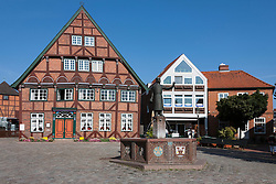 Fountain in front of old town houses, Lutjenburg, Schleswig-Holstein, Germany