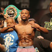 """Floyd Mayweather Jr. poses during the official weigh-ins for the Mayweather versus Maidana boxing match slated as """"The Moment"""", at the MGM Grand hotel on Friday, May 2, 2014 in Las Vegas, Nevada.  (AP Photo/Alex Menendez)"""