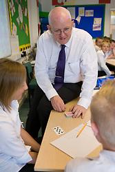 Teacher showing pupils a card trick,