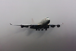 "January 3rd 2015, Heathrow Airport, London. Low cloud and rain provide ideal conditions to observe wake vortexes and ""fluffing"" as moisture condenses over the wings of landing aircraft. With the runway visible only at the last minute, several planes had to perform a ""go-round"", abandoning their first attempts to land. PICTURED: With water vapour streaming from its wings and extended flaps, a Virgin Atlantic Boeing 747 emerges from the low cloud as it prepares to land at London Heathrow's runway 27L."