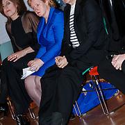 NLD/Rotterdam/20130209 - De Franse modeontwerper Jean Paul Gaultier opent zijn tentoonstelling in de Kunsthal Rotterdam, Jean Paul Gaultier met Uggs laarzen en wethouder Alexandra C. van Huffelen