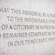 """An inscription that reads """"May this memorial be a tribute to the indomitable spirit of a citizenry in World War II who remained steadfast in their faith in our democratic system,"""" a quote by US Congressman and former internee Norman Mineta at the Memorial to Japanese-American Patriotism in World War II near the US Capitol in Washington DC. The memorial was designed by Davis Buckley and Nina Akamu and commemorates those held in Japanese American internment camps during World War II."""