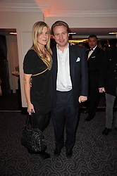 JOE BAMFORD and his wife ALEX at Quintessentially's 10th birthday party held at The Savoy Hotel, London on 13th December 2010.