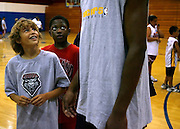 Photo by Steven St. John..Camp attendees, including Alex Herig, left, got a change to look up to the former UNM and current Indiana Pacers star at the Danny Granger Basketball Camp in July 2006 at West Mesa High School. Camper in the middle is not Identified.