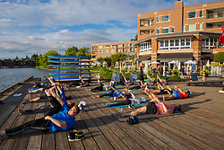 United States, Washington, Kirkland. Outdoor yoga class at Carillon Point.