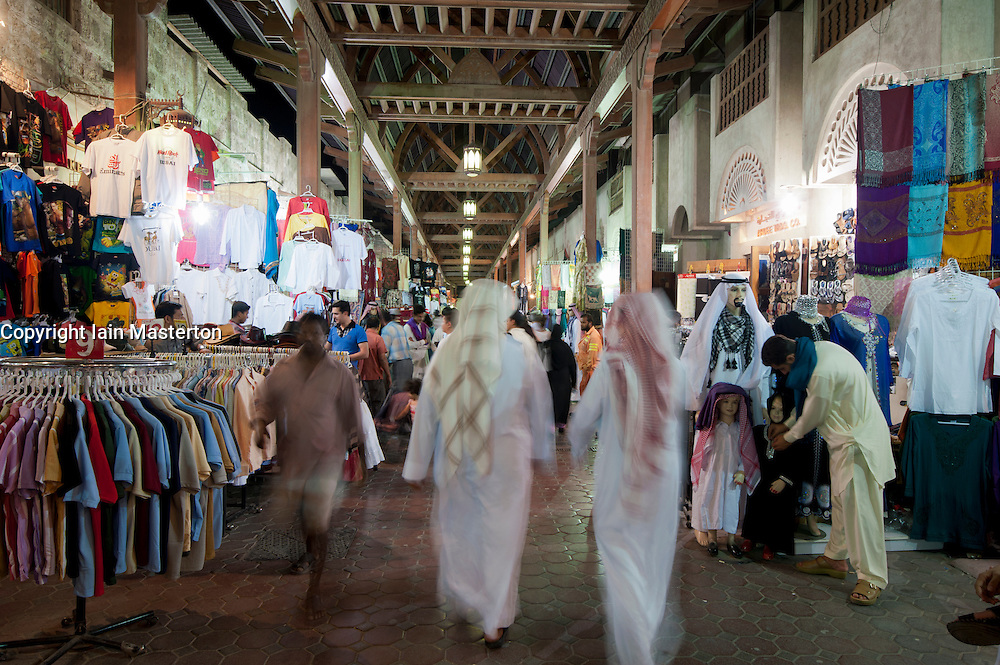 Busy Souq at night in Bur Dubai or Old Dubai, United Arab Emirates UAE